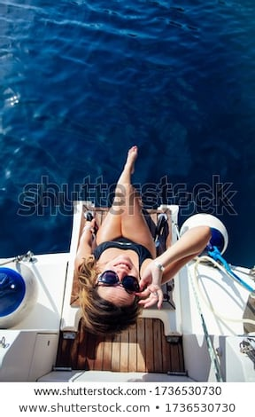 Pretty young woman relaxing on the yacht at sunny day Stock photo © boggy