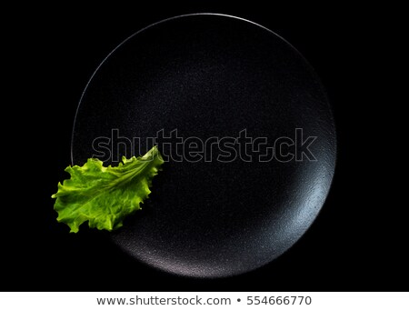 Head of lettuce isolated on stone. Stock photo © lichtmeister