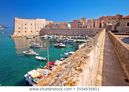 Dubrovnik. Historic city walls walk and Saint Ivan fortress in D Stock photo © xbrchx