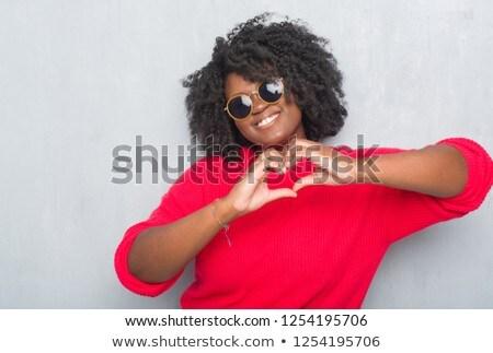 афроамериканец женщину Солнцезащитные очки лет очки Сток-фото © dolgachov