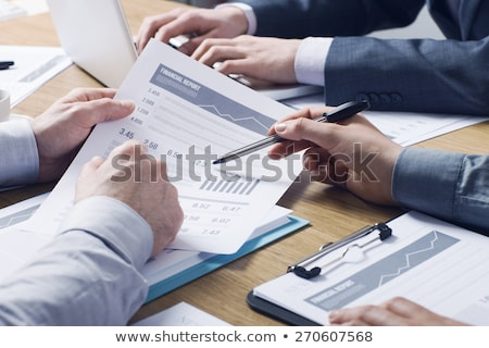 Team analyzing financial data in charts on a table Stock photo © Kzenon
