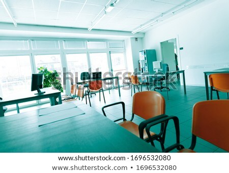 Empty desks and seats during corona virus pandemic Stock photo © Giulio_Fornasar