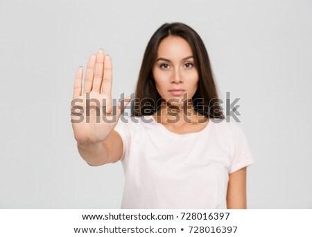 Giovani asian donna stop gesto Foto d'archivio © dolgachov