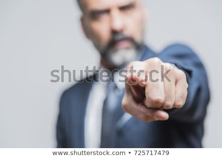 handsome businessman pointing at you stock photo © stockyimages