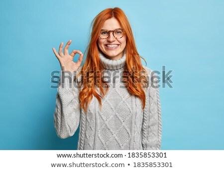 Radosny młoda kobieta w porządku gest szary Zdjęcia stock © deandrobot