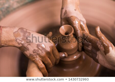 Male and female potter playing with bowl Stock photo © wavebreak_media