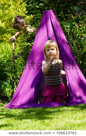 Girl in a teepee, shot from outside Stock photo © IS2