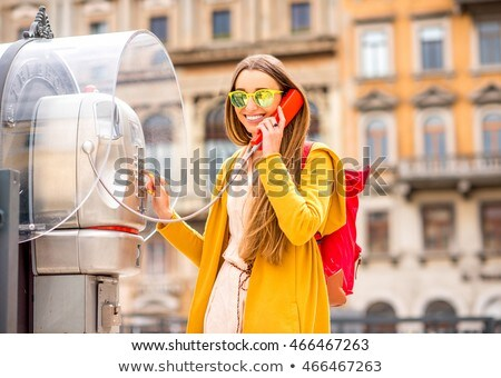Woman on payphone in street Stock photo © IS2
