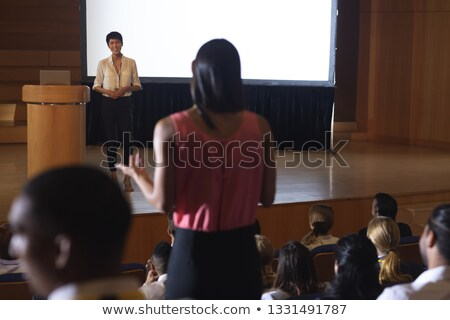 Front view of beautiful Asian businesswoman discussing while woman from the audience standing and as Stock photo © wavebreak_media