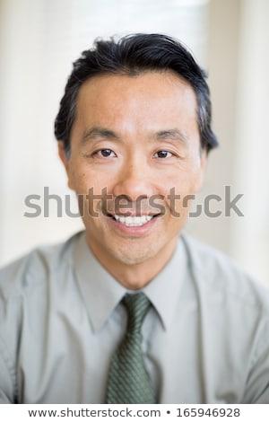 Frente vista Asia doctor de sexo masculino mirando médicos Foto stock © wavebreak_media
