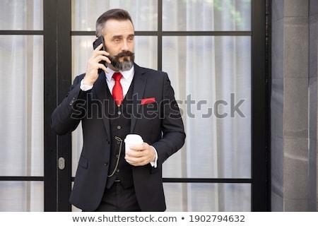 画像 成熟した あごひげを生やした ビジネスマン 携帯電話 ストックフォト © deandrobot