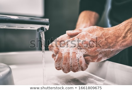 Corona virus travel prevention wash hands with soap and hot water. Hand hygiene for coronavirus outb Stock photo © Maridav