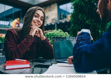 achteraanzicht · vrouw · vergadering · tabel · met · behulp · van · laptop · computer - stockfoto © deandrobot