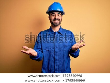 Mechanic with arm out in a welcoming gesture. Stock photo © RAStudio