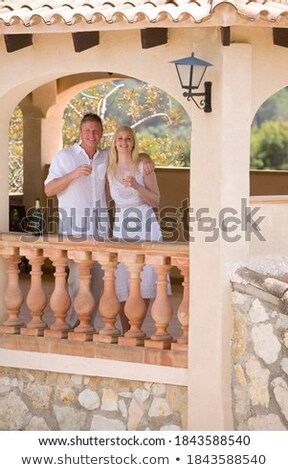 Paar Getränke stehen Balkon Resort glücklich Stock foto © wavebreak_media