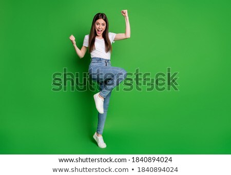 excited woman with colored outfit screaming with open arms Stock photo © feedough
