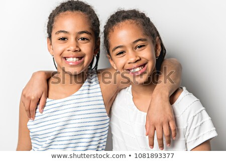 Adorable african twin little girls on studio gray background Stock photo © Lopolo