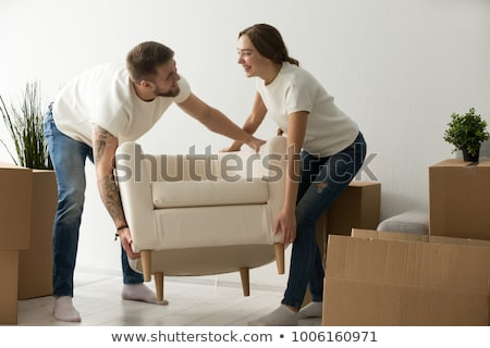 Move into new home. Husband and wife carry sofa, furnish living room after renovation, happy to buy  Stock photo © vkstudio