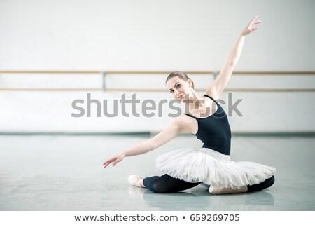 Professional female ballerina practices dance in hall, stretches Stock photo © vkstudio