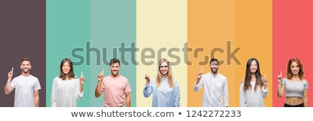 happy woman showing one finger or pointing up Stock photo © dolgachov