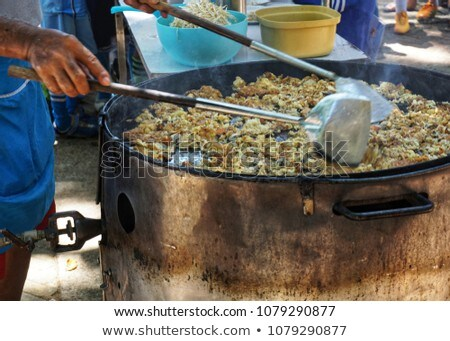 Chef Cooking Meal for Clients, Man Frying Eggs Stock photo © robuart