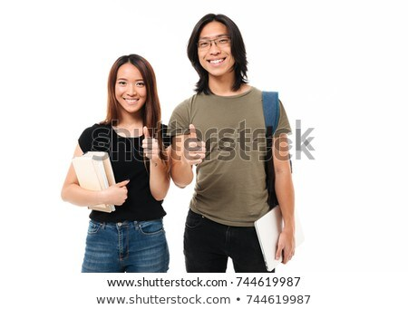 student girl with books and bag showing thumbs up Stock photo © dolgachov