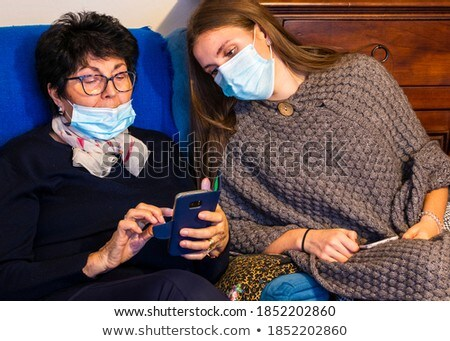 grandmother and granddaughter with smartphone Stock photo © dolgachov