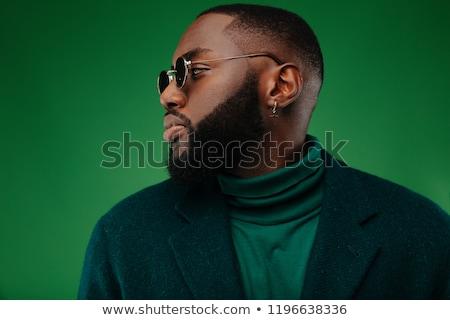 Vonzó férfi pózol stúdió izolált papír Stock fotó © bmonteny