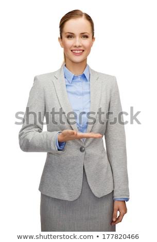 Empresária trabalhando algo imaginário quadro negócio Foto stock © dolgachov