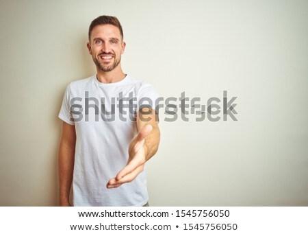 Homme offrant handshake blanche portrait exécutif Photo stock © wavebreak_media