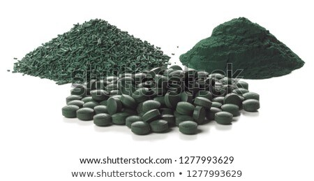 Spirulina flakes, tablets and powder over white background. Stock photo © olivier_le_moal