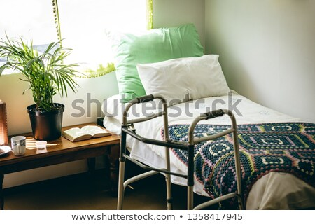 Front view of empty bed and walker in bed room at retirement home Stock photo © wavebreak_media