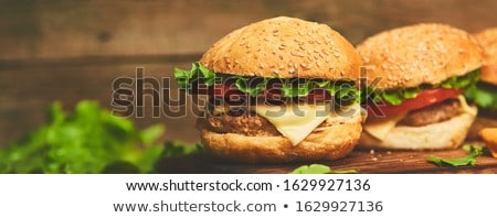 Banner of Craft beef burger on wooden table isolated on black background. Stock photo © Illia