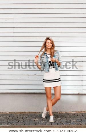 Nő fehér fából készült fal mosoly távolság Stock fotó © ElenaBatkova