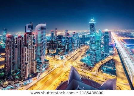 Aerial night view of Dubai in United Arab Emirates, metropolitan cityscape Stock photo © Anneleven