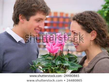 pair looks against each other in flower shop stock photo © paha_l