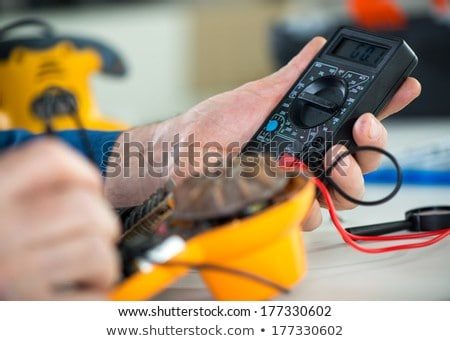 Electrician using a multimeter Stock photo © photography33