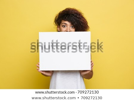 Attractive Woman Holding Up a Blank Sign - Isolated Stock photo © filipw