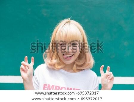 retrato · sorridente · mulher · bonita · câmera · isolado - foto stock © bmonteny