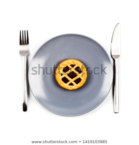 Chocolate tart on grey ceramic plate, fork and knife on white ba Stock photo © marylooo