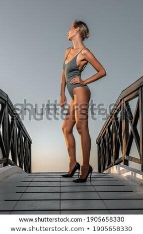 Loiro elegante mulher posando dourado biquíni Foto stock © dashapetrenko