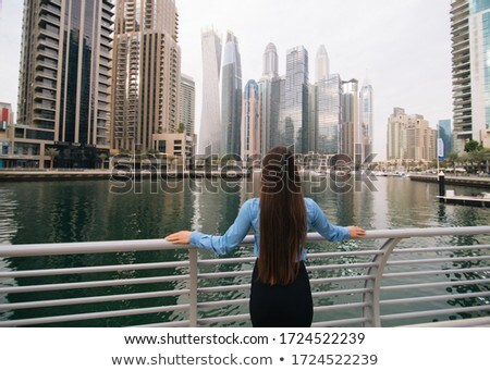 rear view of relaxed businesswoman thinking stock photo © feedough