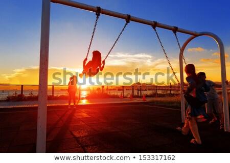 Silhouet vader zoon spelen swing zonsondergang hand Stockfoto © galitskaya
