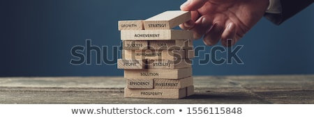 Business start up: Businessman building business-word. Stock photo © lichtmeister