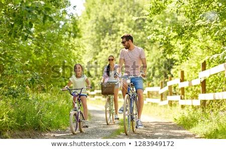 kobieta · dziecko · rowerowe · parku · miłości · zabawy - zdjęcia stock © dolgachov