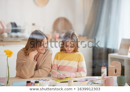 children drawing and making crafts at home Stock photo © dolgachov