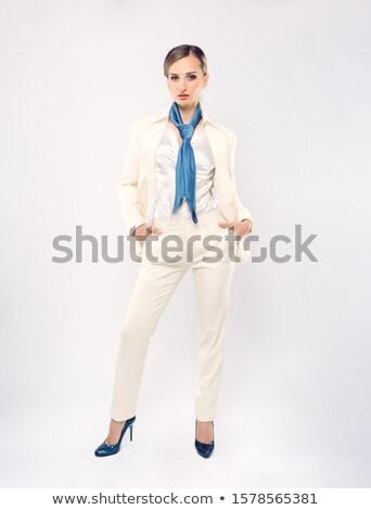 Elegante empresária branco terno azul Foto stock © Kzenon