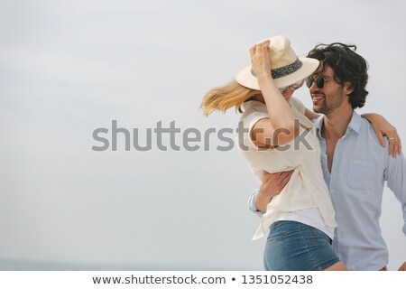 Side view of young Caucasian couple looking at each other and dancing on beach on sunny day Stock photo © wavebreak_media