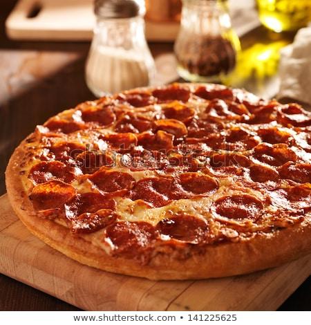 Pepperoni pizza közelkép szelektív fókusz finom étvágygerjesztő Stock fotó © dash