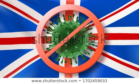 Stock photo: Warning sign with crossed out Coronavirus bacteria on the background of British flag.